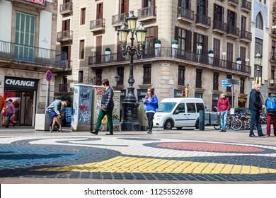 BARCELONA - MARCH, 2018: Pavement mosaic by Joan Miro at La Rambla pederestian street in Barcelona Spain