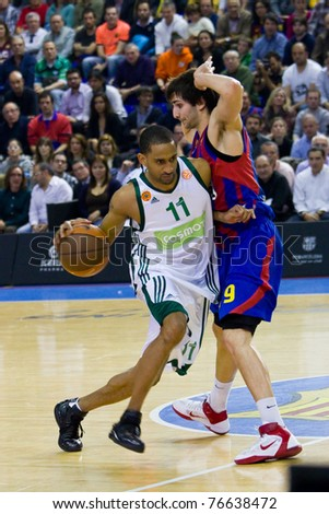 d74433af2b5 BARCELONA - MARCH 24  Drew Nicholas (11) and Ricky Rubio (9) in action  during the Euroleague basketball match between Barcelona and Panathinaikos