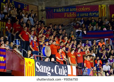 BARCELONA - MARCH 24: Unidentified Barcelona supporters cheer during the Euroleague basketball match Barcelona - Panathinaikos, 71-75, on March 24, 2011 in Palau Blaugrana stadium in Barcelona, Spain.