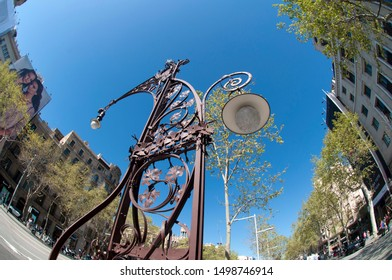 Barcelona, March 28, 2017. The iconic lampost, designed by Pere Falques, in Paseo de Gracia, the Golden Mile and luxurious avenue in Barcelona, Gracia District, Spain.