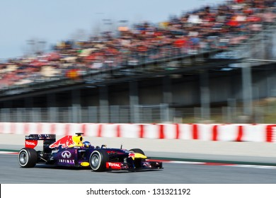 BARCELONA - MARCH 3: Sebastian Vettel of Infiniti Red Bull Racing F1 team passes grandstand with spectators at Formula One Test Days at Catalunya circuit on March 3, 2013 in Barcelona, Spain.