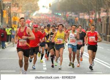BARCELONA - MARCH, 3: Unidentified runners on the street during Barcelona Marathon on March 3, 2011 in Barcelona, Spain