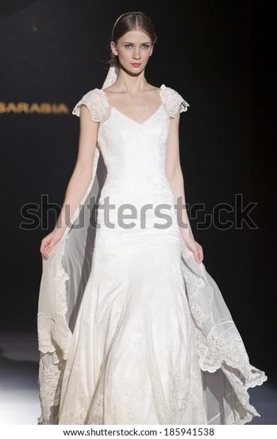 BARCELONA - MAY 02: A model walks on the Franc Sarabia catwalk during the Barcelona Bridal Week runway on May 02, 2013 in Barcelona, Spain.
