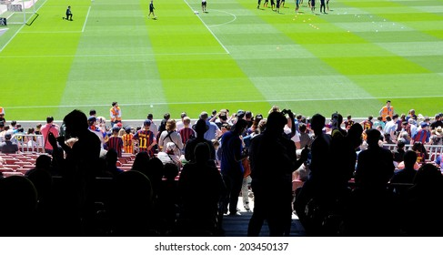 BARCELONA - MAY 03: Silhouettes of people at the Camp Nou Stadium prior to the La Liga match between FC Barcelona and Getafe CF on May 3, 2014 in Barcelona, Spain.
