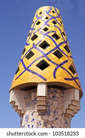 BARCELONA - MAY 1: The yellow mosaic chimney made of broken ceramic tiles on roof of Palau G�¼ell, one of the earliest Gaudi's masterpieces, on May 1, 2012 in Barcelona, Spain.
