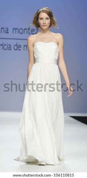 BARCELONA - MAY 10: A model walks on the Joana Montez & Patricia de Melo catwalk during the Barcelona Bridal Week runway on May 10, 2012 in Barcelona, Spain.