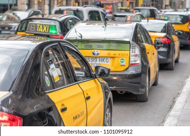 BARCELONA - MAY 11, 2018: Taxis along city roads. Barcelona attracts 10 million tourists annually.