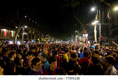 BARCELONA - MAY 11: Some supporters of FC Barcelona celebrate the Spanish League Championship victory in Catalunya square and Rambla street, on May 11, 2011 in Barcelona, Spain.