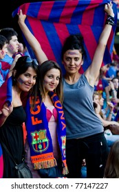 BARCELONA - MAY 13: Unidentified FC Barcelona supporters celebrate the Spanish League Championship victory in Camp Nou stadium, on May 13, 2011 in Barcelona, Spain.
