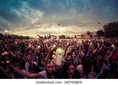 BARCELONA - MAY 18: The crowd with their phones raised in a concert at Primavera Pop Festival on May 18, 2019 in Barcelona, Spain.