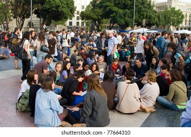 BARCELONA - MAY  19: People protest and do a peaceful sit-in against unemployment and political corruption during the Spanish Revolution days, on May 19, 2011 in Catalunya square, Barcelona, Spain.