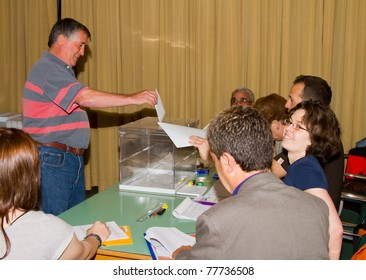 BARCELONA - MAY 22: Unidentified man votes at Spanish Municipal Elections, on May 22, 2011 in Barcelona, Spain.
