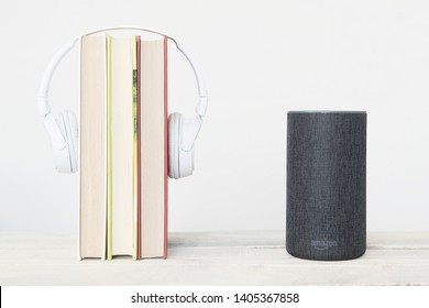 BARCELONA MAY 23: Amazon Alexa Echo device next to some books and hearphones on May 23, 2019 in Barcelona