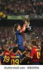 BARCELONA - MAY 23: Carles Puyol of Barcelona holds up the Spanish league trophy after the La Liga match between FC Barcelona and CA Osasuna at the Nou Camp stadium on May 23, 2009 in Barcelona.