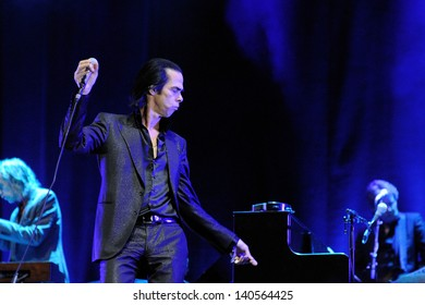 BARCELONA - MAY 25: Nick Cave and the Bad Seeds band, performs at Heineken Primavera Sound 2013 Festival on May 25, 2013 in Barcelona, Spain.