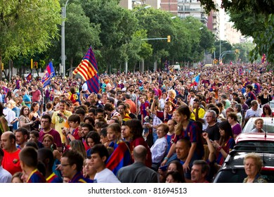 BARCELONA - MAY 29: FC Barcelona players and supporters celebrate the European Champions League and Spanish League trophies, on May 29, 2011 in Barcelona, Spain.