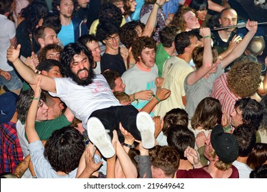 BARCELONA - MAY 30: The audience doing crowd surfing (also known as mosh pit) at Heineken Primavera Sound 2014 Festival on May 30, 2014 in Barcelona, Spain.