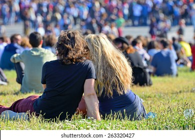 BARCELONA - MAY 30: A couple from the audience watch a concert together sitting in the grass at Heineken Primavera Sound 2014 Festival (PS14) on May 30, 2014 in Barcelona, Spain.