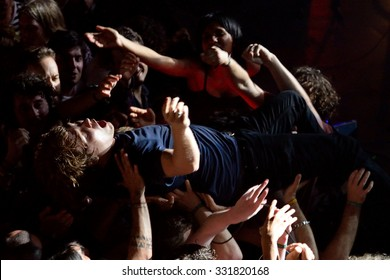 BARCELONA - MAY 30: The guitar player of Ty Segall (band) performs above the spectators (crowd surfing or mosh pit) at Heineken Primavera Sound 2014 Festival on May 30, 2014 in Barcelona, Spain.