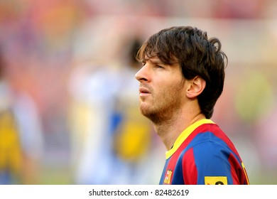 BARCELONA - MAY 8: Leo Messi of FC Barcelona watch to the scoreboard during the match between FC Barcelona and RCD Espanyol at the Nou Camp Stadium on May 8, 2011 in Barcelona, Spain