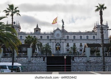 Barcelona military barracks building with flag and palms. Photo made on 10 May 2017 in Barcelona, Spain.