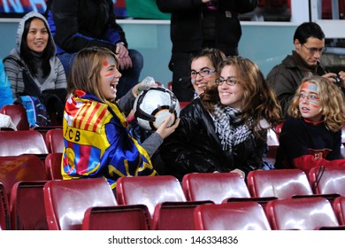 BARCELONA - NOV 10: unidentified Audience return the ball at the Camp Nou Stadium on the Spanish Cup (Copa del Rey) match between F.C Barcelona and Cultural Leonesa on November 10, 2009 in Barcelona, Spain.