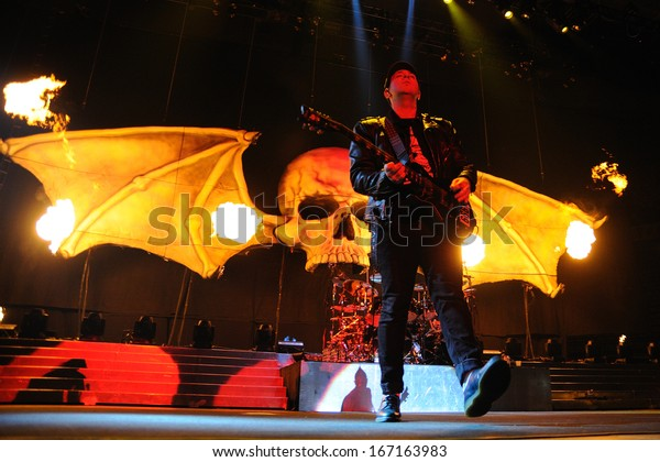 BARCELONA - NOV 25: Avenged Sevenfold, famous heavy metal band with over 15 million fans on Facebook, performs at Olimpic de Badalona stage on November 25, 2013 in Barcelona, Spain.