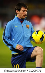 BARCELONA - NOV 29: Leo Messi of FC Barcelona playing with the ball  before the spanish league match against Rayo Vallecano at the Nou Camp Stadium on November 29, 2011 in Barcelona, Spain