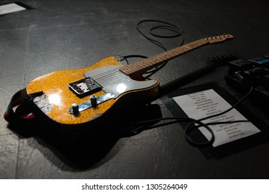 BARCELONA - NOV 30: A guitar in the floor after a concert at Apolo stage on November 30, 2018 in Barcelona, Spain.