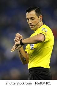 BARCELONA - NOV, 30: Referee Teixeira Vitienes check the time during a Spanish League match between RCD Espanyol vs Real Sociedad at the Estadi Cornella on November 30, 2013 in Barcelona, Spain