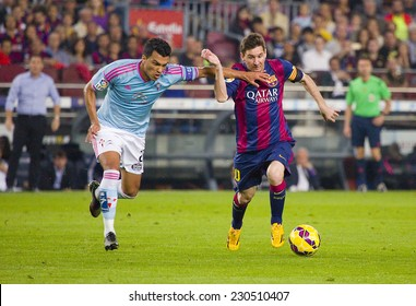 BARCELONA - NOVEMBER 1: Lionel Messi (R) of FCB in action at Spanish League match between FC Barcelona and Celta de Vigo, final score 0-1, on November 1, 2014, in Camp Nou stadium, Barcelona, Spain.
