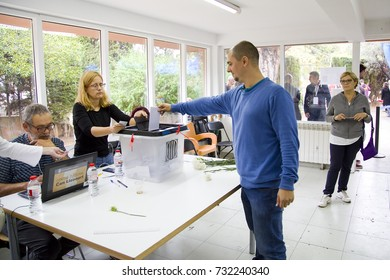 BARCELONA - OCTOBER 1: Unidentified man votes in referendum on Catalonia independence, in defiance of the Spanish government, on October 1, 2017, in Barcelona, Spain.