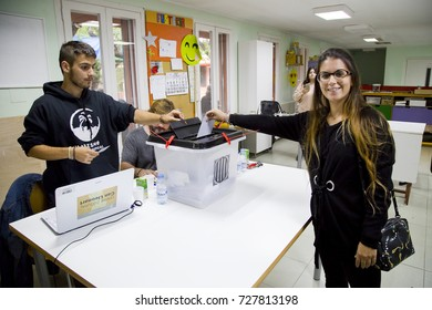 BARCELONA - OCTOBER 1: Unidentified people votes in referendum on Catalonia independence, in defiance of the central government in Madrid, on October 1, 2017, in Barcelona, Spain.