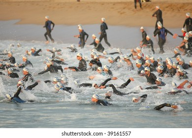 BARCELONA - OCTOBER 18 : Competitor swim at the start of Barcelona Triathlon 2009 Event October 18, 2009 in Barcelona, Spain.