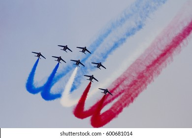 BARCELONA - OCTOBER 2: Unidentified pilots of Patrouille de France perform aerobatics during the aerial plane exhibition Festa al Cel festival, on October 2, 2011 in Barcelona, Spain.