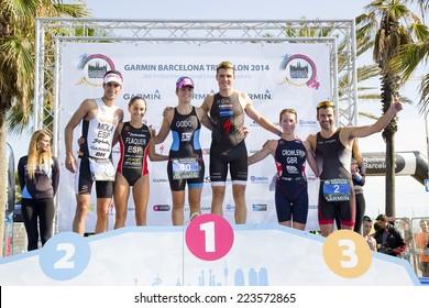 BARCELONA - OCTOBER 5: Winners of Garmin Barcelona Triathlon, on October 5, 2014, in Barcelona, Spain. L-R: Mario Mola, Anna Flaquer, Anna Godoy, Javier Gomez Noya, Eloise Crowley and Francesc Godoy.