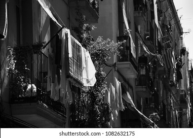 Barcelona. Old city houses with with drying laundry and Catalonia flag. Black and white photo.