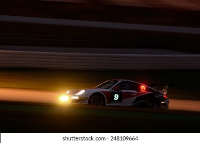 BARCELONA, SAPIN - SEP 7: Team formed by Klaus Werner, Fabian Engel and Jens Feucht races in a Porsche 997 GT3 in the 24 Hours of Barcelona, at Catalunya Circuit, on Sep 7, 2014 in Barcelona, Spain.