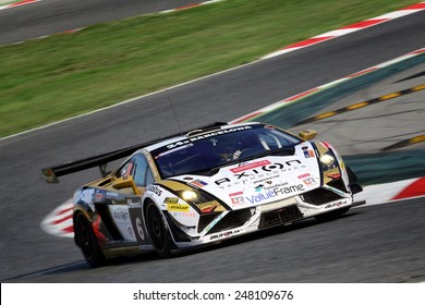 BARCELONA, SAPIN - SEP 7: Team formed by Liam Talbot, Jean-Charles Perrin and Fredy Barth races in a Lamborghini in the 24 Hours of Barcelona, at Catalunya Circuit, on Sep 7, 2014 in Barcelona, Spain