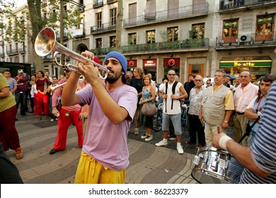 BARCELONA - SEPT, 24: Trumpeter of music troop in full swing performing his show at Las Ramblas during a Festival City on September 24, 2004 in Barcelona, Spain