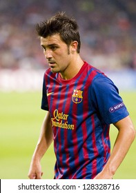 BARCELONA - SEPTEMBER 13: David Villa of FCB in action at the Champions League match between FC Barcelona and AC Milan, 2 - 2, on September 13, 2011, in Camp Nou, Barcelona, Spain.