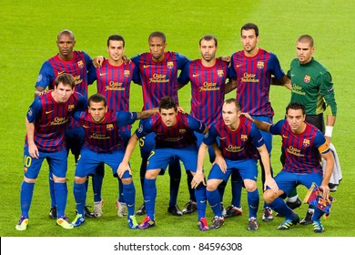 BARCELONA - SEPTEMBER 13: Barcelona players before the Champions League match between FC Barcelona and AC Milan, final score 2 - 2, on September 13, 2011, in Camp Nou stadium, Barcelona, Spain.