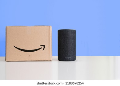 BARCELONA - SEPTEMBER 2018: Amazon Echo Smart Home Alexa Voice Service next to an order in a cardboard box in a living room on September 26, 2018 in Barcelona.