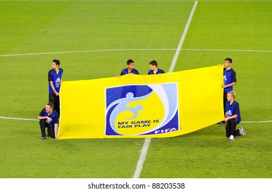 BARCELONA - SEPTEMBER 4: Unidentified people with FIFA Fair Play flag before the friendly match between Mexico and Chile, 1 - 0, on September 4, 2011, in Cornella stadium, Barcelona, Spain.
