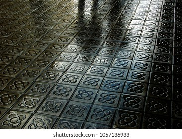 Barcelona. Silhouette of couple reflected on wet flower street paving. Romantic vacation background.