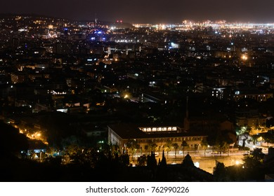 Barcelona skyline and cityscape by night. Panorama of illuminated night city from hills, lighting of buildings, visual pollution