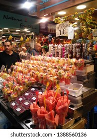 Barcelona, Spain - 01.10.18: Look of a fruit spot at the most famous market in Barcelona - the one based at La Rambla, rich with many spots for fresh fruits, food and drinks. Cups with wattermelon.
