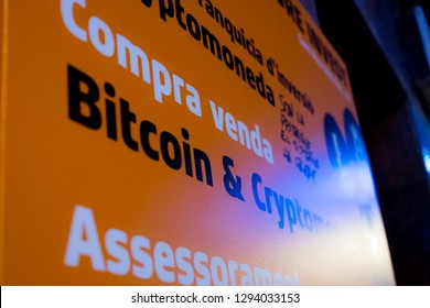 Barcelona, Spain- 02 january 2019: close up of bitcon cryptocurrency agency sign at night in spanish