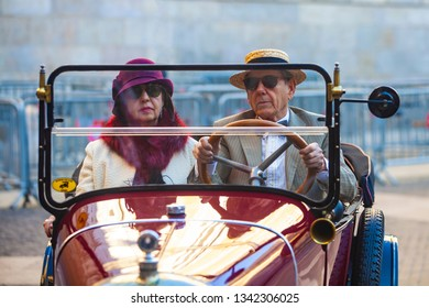 Barcelona / Spain 03 17 2019: Senior citizens drive in a retro car. Old people on vacation.