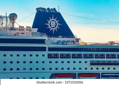 """Barcelona / Spain 04 04 2019: Cruise liner tube with logo """"MSC"""". Exhaust pipe of a huge passenger ship in the port of Barcelona. Ship's funnel."""